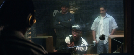 (L to R) Eazy-E (JASON MITCHELL) raps while Ice Cube (O'SHEA JACKSON, JR.), Dr. Dre (COREY HAWKINS) and DJ Yella (NEIL BROWN, JR.) listen in Straight Outta Compton. Credit: Jaimie Trueblood